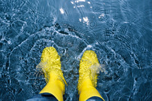 Rubber Boots Splashing In The ...