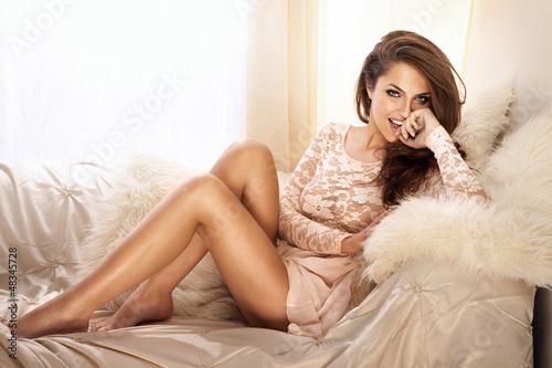 Fotografia  Fashion photo of beautiful young woman in lace dress, smiling
