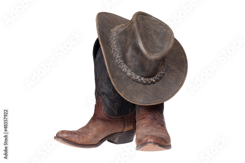 Fotografie, Obraz  Cowboy boots and hat isolated with clipping path