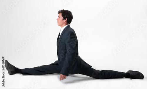 Fotografie, Obraz  Good-looking businessman doing splits