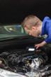 Repairman examining car engine