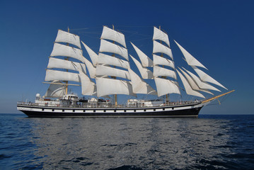 Fototapeta Sailing frigate under full sail in the ocean