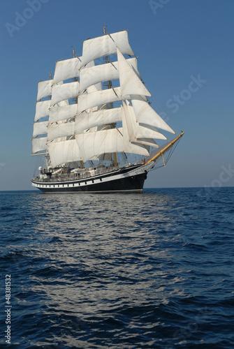 Photo Sailing frigate under full sail in the ocean