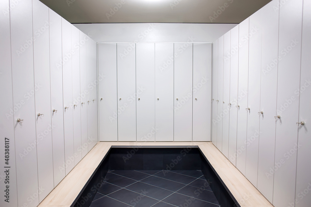 Photo & art print gym dressing room with lots of white lockers
