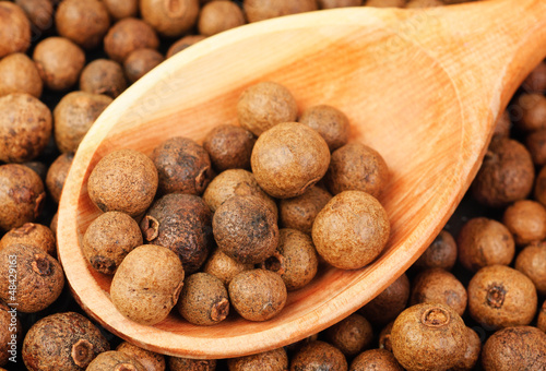 Background texture of whole allspice(jamaica pepper)