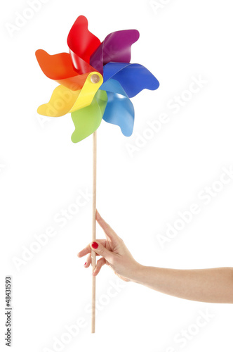 Fotografia, Obraz  Hand is holding colorful pinwheel toy