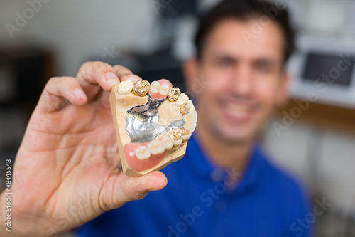 Dental technician presenting dental prosthesis Fototapeta