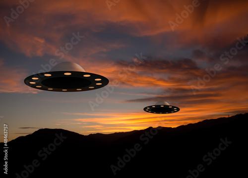 Foto op Canvas UFO UFO flying saucers over sunset landscape