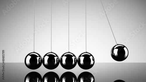 Fotografie, Obraz  Balancing balls newtons cradle over dark background