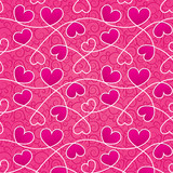 Texture for a Valentine day with pink hearts and vintage pattern