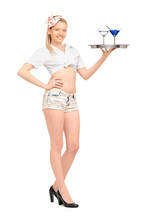 Young Waitress In Short Pants Holding A Tray With Two Cocktails