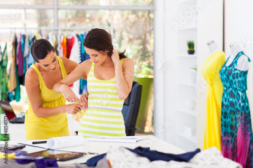 Fotografie, Obraz  female tailor measuring customer waist size