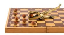 Gold Crocodile Nut Crush Tool Chess Board Isolated