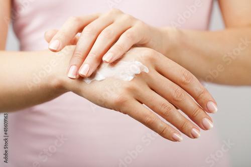 Fototapeta  beautiful woman hands with cream