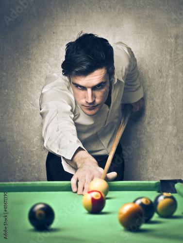 Fotografie, Tablou  man playing pool
