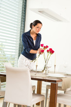 Woman Decorating Red Roses Dining Room Wife