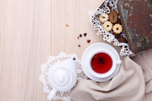 Wooden Table For Breakfast With Teapot Cup Of Tea And Biscuits