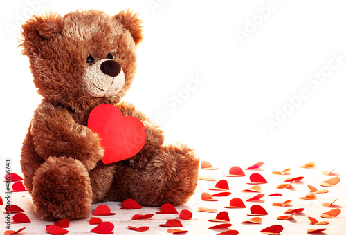 Lonely teddy bear with heart in a paws #48656743