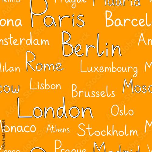 Photo  European cities typographic orange seamless background, vector