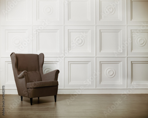 Fototapeta One classic armchair against a white wall and floor