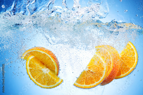 Fototapety, obrazy: Orange Slices falling deeply under water with a big splash