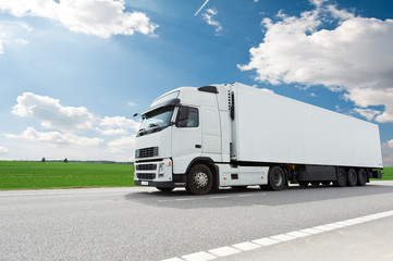 Fototapeta white lorry with trailer over blue sky