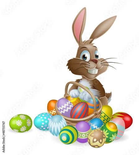 Fotografia  Easter bunny rabbit with Easter eggs basket