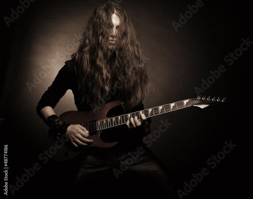 Photo  Furious metal guitarist
