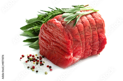 Photo  Raw beef  isolated on white