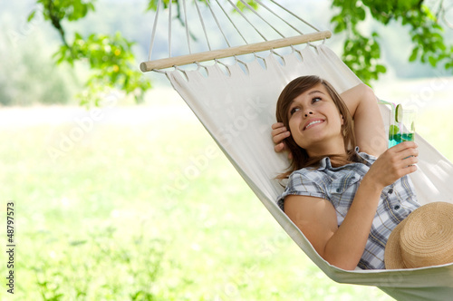 Poster  Young woman resting on hammock