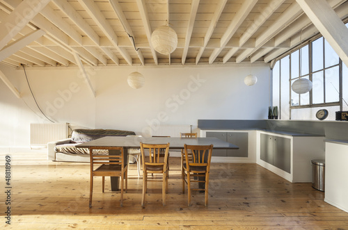 Obraz wide room of loft, beams and wooden floor - fototapety do salonu