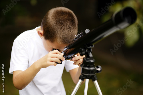 little boy with telescope Canvas Print