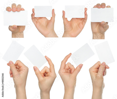 Fotografía  Hands hold business cards collage on white background .