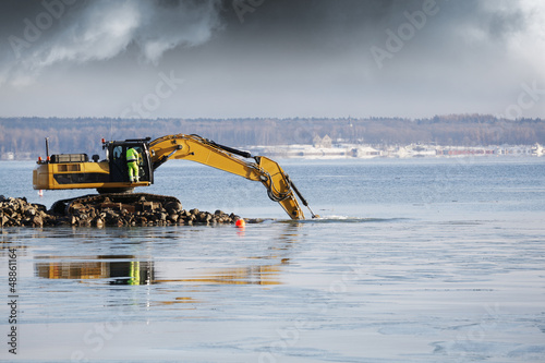 Fotografia, Obraz  bulldozer and driver dredging in the sea