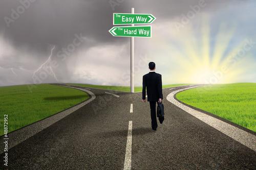 Fotografie, Obraz  Businessman choosing easy way