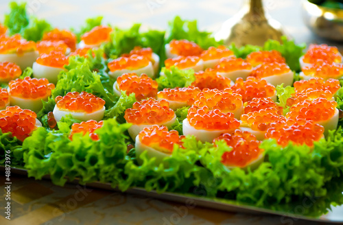 Stuffed eggs with red caviar