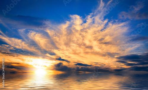 Foto-Leinwand - Spektakulärer Sonnenuntergang am Meer