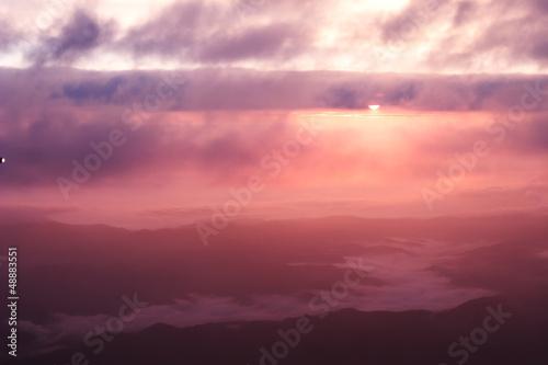 Papiers peints Grenat Sunrise over mountain