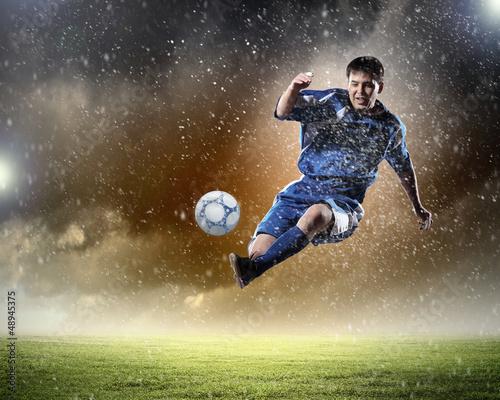 Printed kitchen splashbacks Soccer ball football player striking the ball