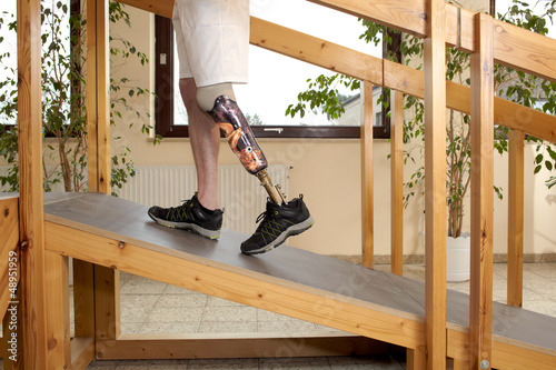 Male prosthesis wearer training to climb a slope Wallpaper Mural