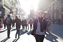 Urban Girl Striding Through Ci...