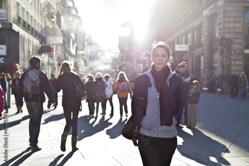 Fotografia, Obraz Urban girl striding through city area