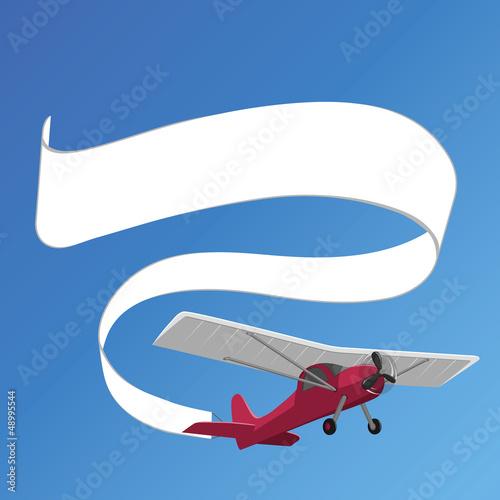 In de dag Vliegtuigen, ballon plane pulling white banner on the background of clear sky