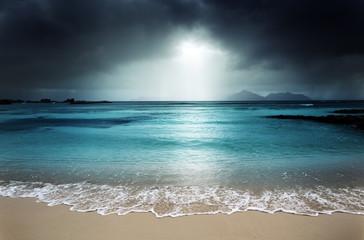 Fototapetadark sky on the beach of la Digue island, Seychelles