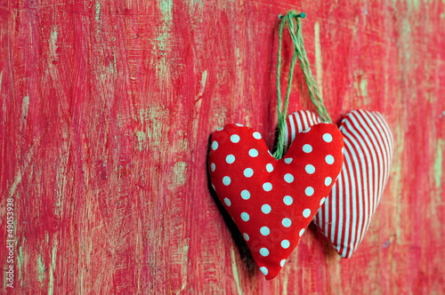 Hearts on red painted background