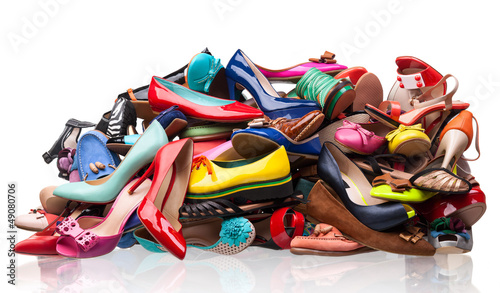 Fotografía  Pile of various female shoes over white