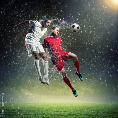 Door stickers Football two football players striking the ball