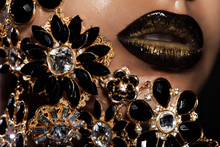 Female Lips With Golden Jewelry