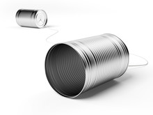 Two Tin Cans Attached With Str...