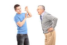 Mature Man Yelling At A Young Man